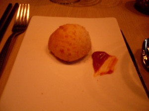 Complimentary roll/biscuit/tasty's baked thing in a long time accompanied by a plum?/jalapeno butter that was booth sweet & spicy