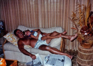 Heather and her Pop-pop watching TV, July 1985. Notice the Florida tans.