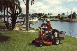 One of dozens of pictures of Heather riding the lawnmower with her Pop-pop at his home in Port Charlotte, FL