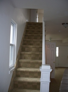 The stairs leading up to the bedrooms.